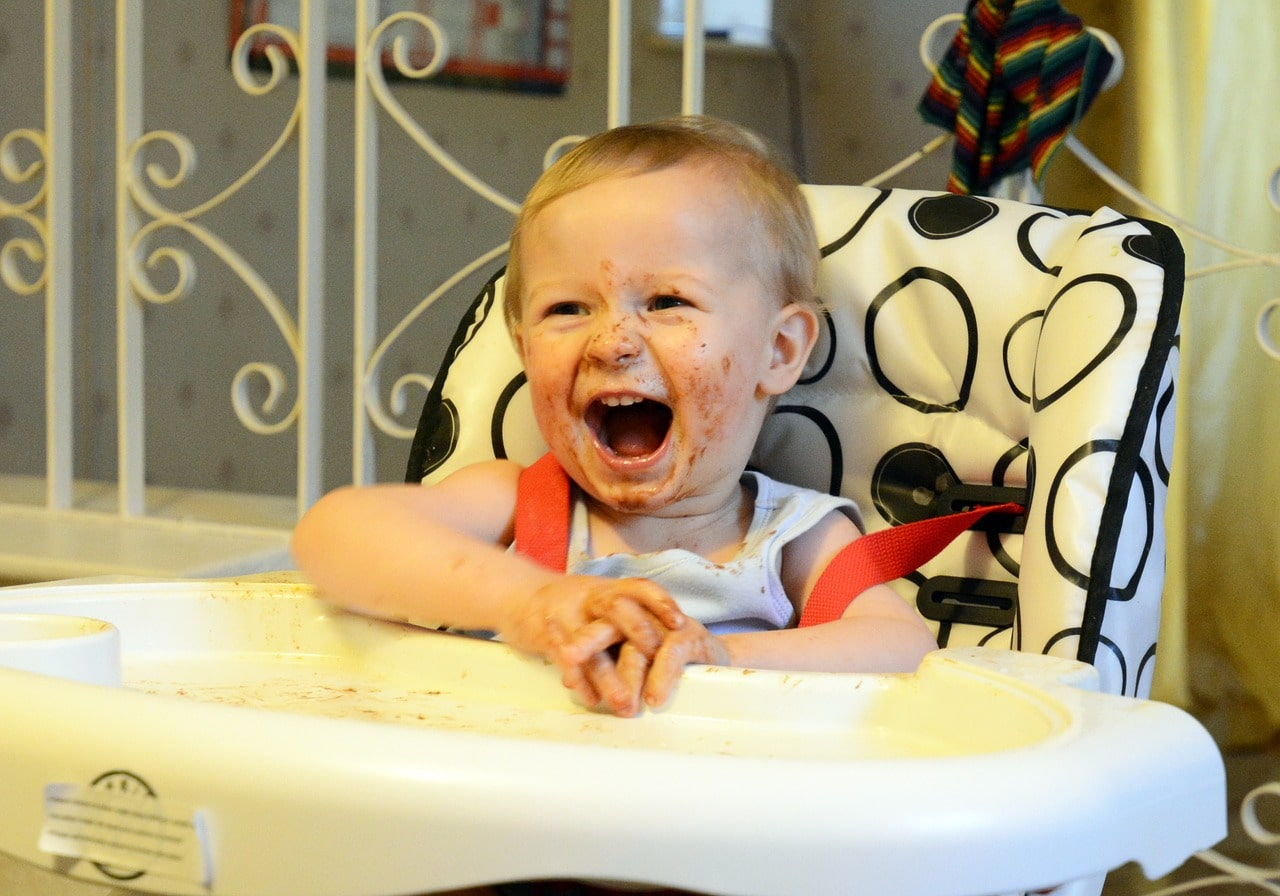 Child eating on a high chair