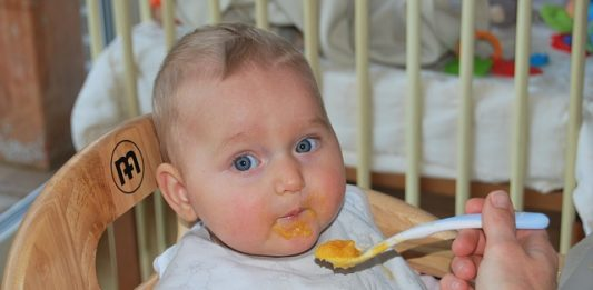 a baby being fed